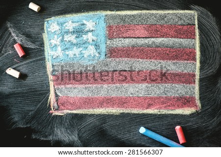 black chalkboard in classroom with flag of us. - stock photo