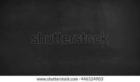 Black chalkboard texture with room for text or drawing. Lots of copy space. - stock photo