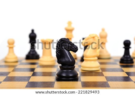 black chess knight on a chess board - stock photo