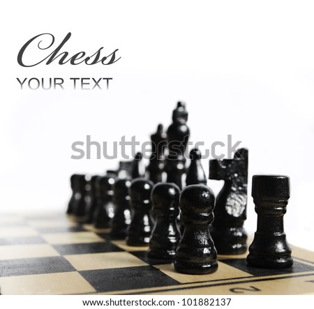 Black chess pieces on chess board isolated over white - stock photo