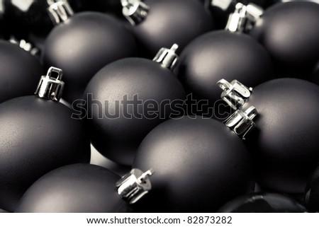 Black Christmas baubles. Shallow dof. - stock photo