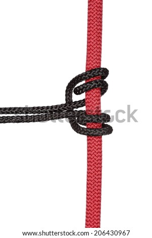 black climbing knot on red rope with white background - stock photo