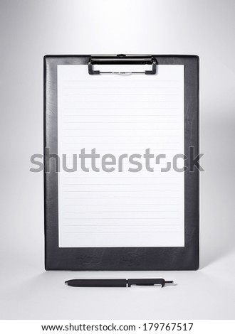 Black Clip board with blank paper and a pen - stock photo