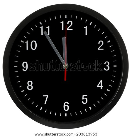 Black clock showing five minutes to midnight, isolated with clipping path - stock photo