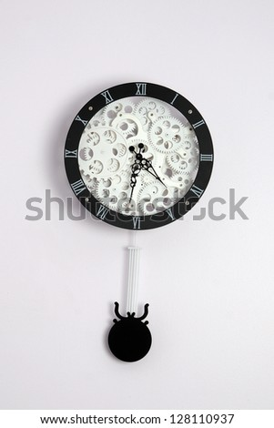 Black clock with gears on white background - stock photo
