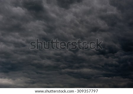 black clouds in the sky (background) - stock photo