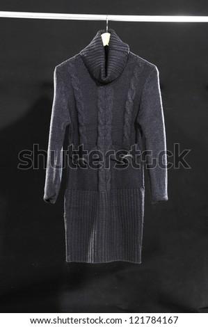 Black coat hanging on hanger - stock photo
