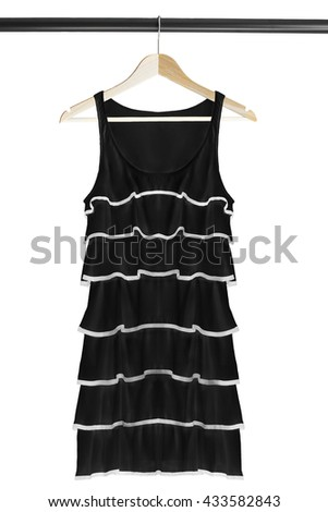 Black cocktail dress on wooden clothes rack isolated over white - stock photo