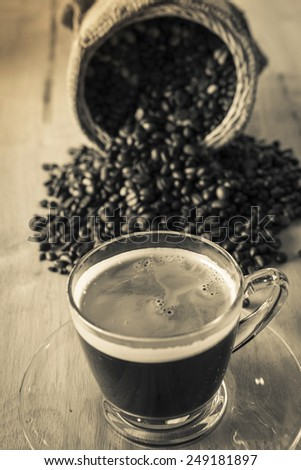 Black coffee, a cup of beans sepia tone - stock photo