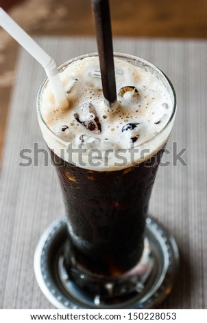 Black coffee, cold is on the table. - stock photo