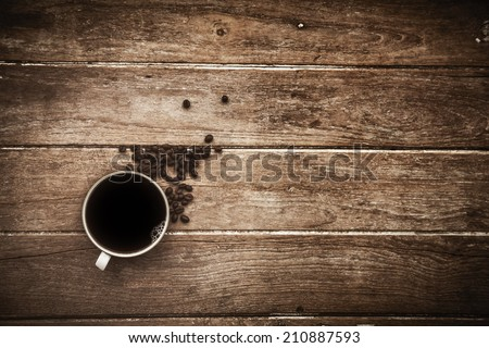 Black coffee on a wooden table - stock photo