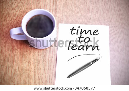 Black coffee on the table with note writing time to learn - stock photo