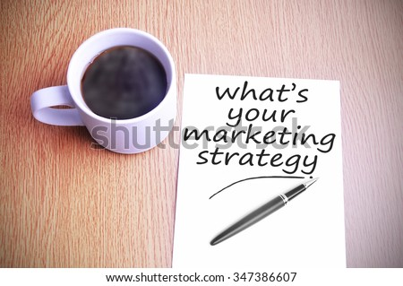 Black coffee on the table with note writing whats your marketing strategy - stock photo