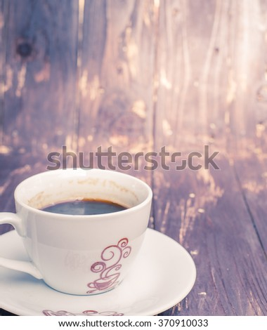 Black coffee on wood background,vintage tone colour style - stock photo