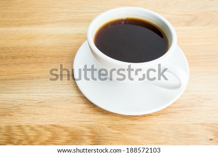 Black coffee on wooden table - stock photo