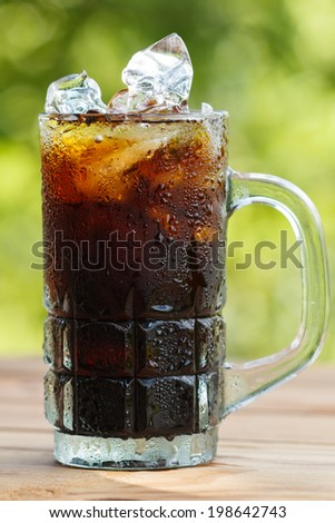 Black coffee with ice on  wooden table - stock photo
