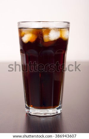Black cola in a glass with ice real, not plastic - stock photo