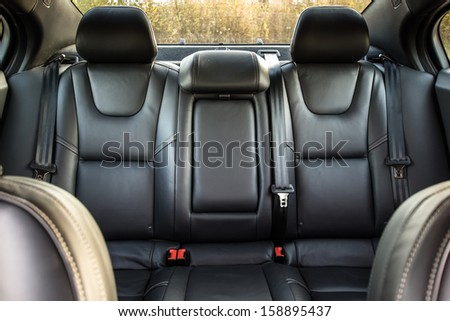 Black color skin luxury town car passengers interior - stock photo