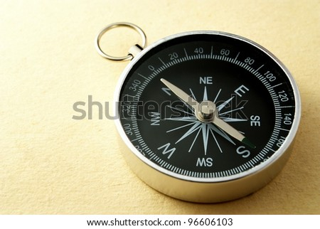 black compass on a gradient yellow background - stock photo