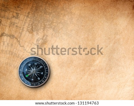 Black Compass on Brown Paper with old map Print background - stock photo