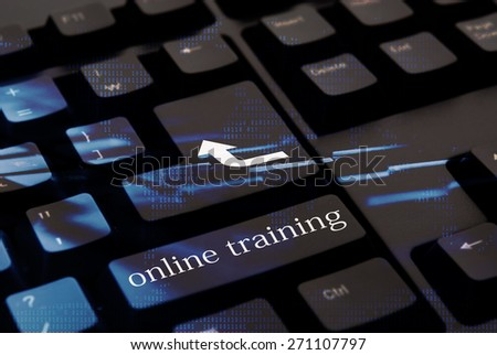 Black computer keyboard with online training button  - stock photo