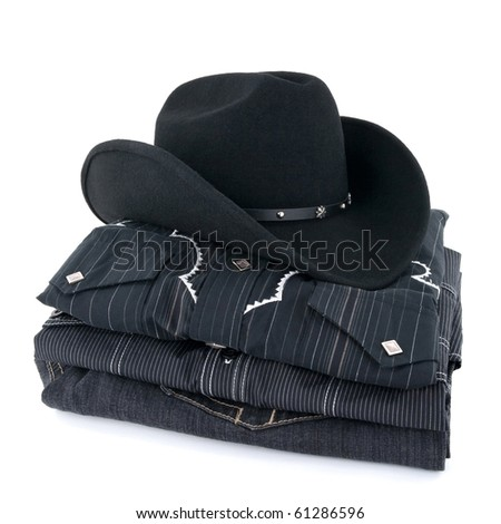 Black cowboy hat and western style clothing on white background. - stock photo