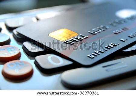 Black credit card on a calculator - stock photo