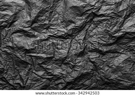 Black crumpled paper for texture and background - stock photo
