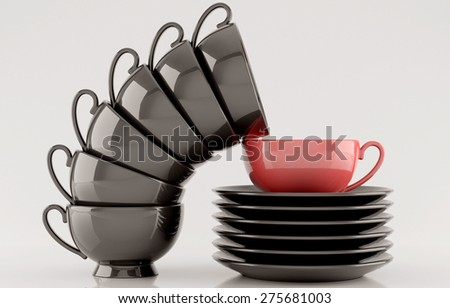 Black cups and saucers on white background - stock photo