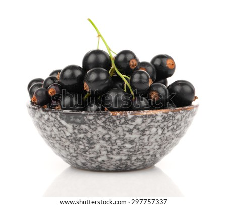 black currant in a bowl, on a white background - stock photo
