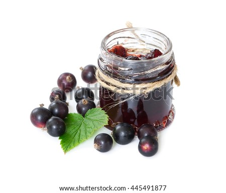 Black currant jam in glass jar isolated on white background. - stock photo