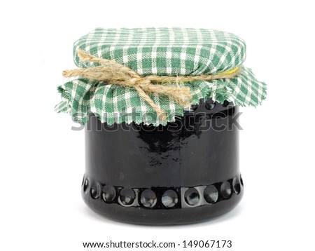 Black currant jam in glass jar on a white background - stock photo