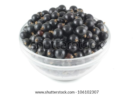 Black currants in a glass bowl isolated on a white background - stock photo