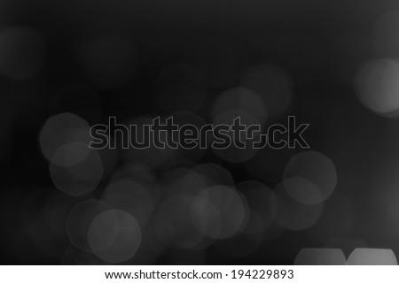 Black Defocused Bokeh twinkling lights Vintage background. - stock photo