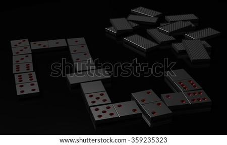 Black domino on black surface - stock photo