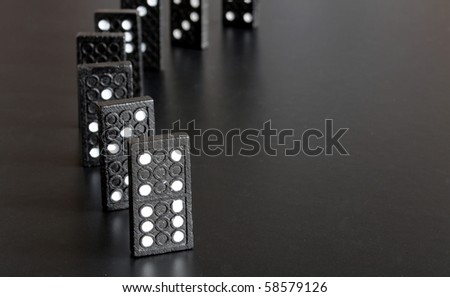 black domino showing financial or economic crisis concept - stock photo