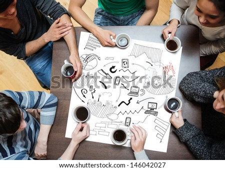 Black drawings of charts drew on a poster during a meeting - stock photo