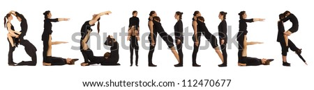 Black dressed people forming BEGINNER word over white - stock photo