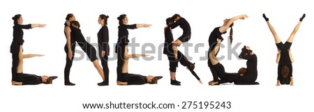 Black dressed people forming ENERGY word over white - stock photo