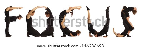 Black dressed people forming FOCUS word over white - stock photo