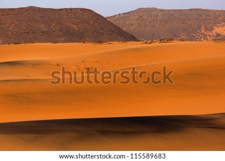 Black dunes in the Sahara desert - stock photo