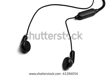 Black earphones isolated on white background - stock photo