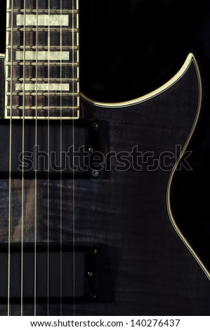Black Electric Guitar on a black background - stock photo
