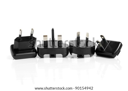 Black electrical adapters on a white background - stock photo