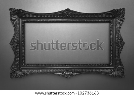 Black elegant frame on dark shiny background, inner and outer clipping paths included - stock photo