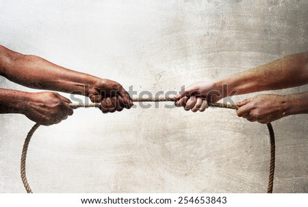 black ethnicity arms with hands pulling rope against white Caucasian race person in stop racism and xenophobia concept, immigration and multiracial  respect isolated on grunge background - stock photo