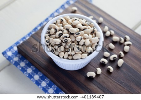 Black Eyed Peas. High angle view of white bowl full of Black Eyed Peas. Very shallow depth of field. - stock photo