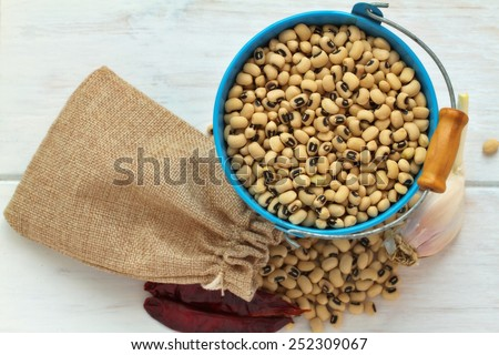 Black eyed peas on a vintage white background - stock photo
