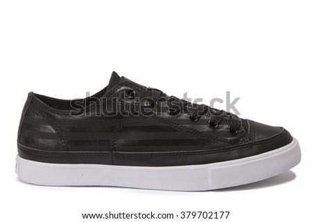 Black female gym shoes - stock photo