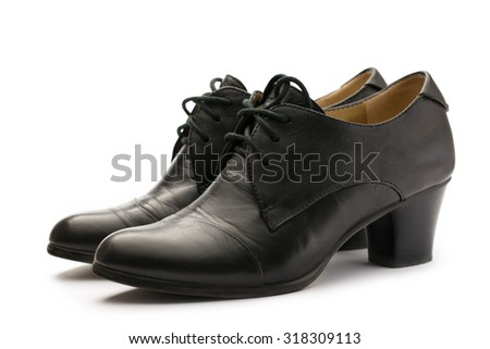 Black female pump leather shoes on white - stock photo